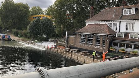 Water is cascading past the Princess of Wales pub into the canal. Picture: Emma Bartholomew