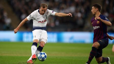 Tottenham Hotspurs' Harry Kane shoots under pressure during the Champions League Group B match at We