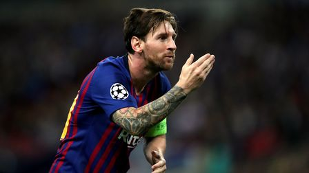 Barcelona's Lionel Messi celebrates scoring his sides third goal during the Champions League Group B