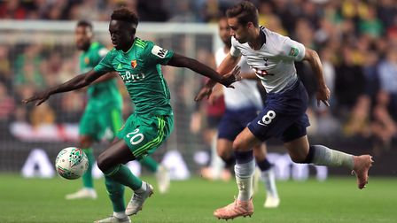 Watford's Domingos Quina (left) and Tottenham Hotspur's Harry Winks battle for the ball at Stadium M