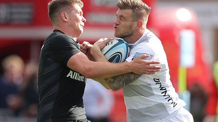 Saracens fly-half Owen Farrell (left) tackles Jason Woodward of Gloucester (pic: Andrew Matthews/PA)