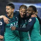 Tottenham Hotspur's Erik Lamela (left) celebrates scoring his side's second goal of the game at Brig