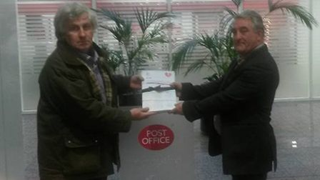CWU representative Huw Davies presents the petition to save St John's Wood Post Office to Ken Penton
