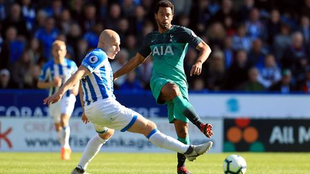 Huddersfield Town's Aaron Mooy (left) and Tottenham Hotspur's Mousa Dembele battle for the ball (pic