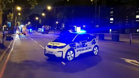 Police at the scene of the crash in Stamford Hill. Picture: @MPSHackney