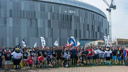 Spurs supporters and former goalkeeper Pat Jennings outside the Tottenham Hotspur Stadium in July ah