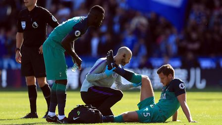 Tottenham Hotspur's Jan Vertonghen receives treatment for an injury at Huddersfield Town (pic: Mike