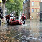A staff member from shop Archi Express being rescued by firefighters. Picture: Kriss Lee