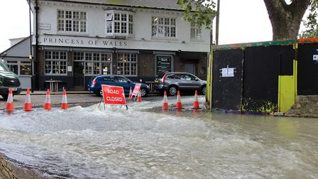 Water gushing by the Princess of Wales pub. Picture: Kriss Lee