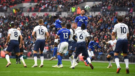 Cardiff City's Sean Morrison wins a header during the Premier League match at Wembley Stadium agains
