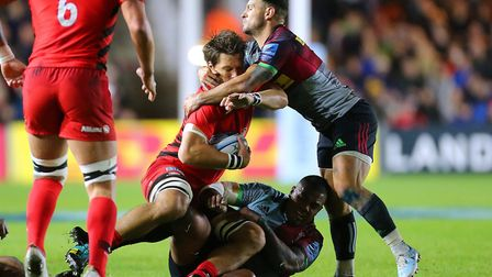 Saracens' Mike Rhodes is tackled by Harlequins' Danny Care during the Gallagher Premiership match at