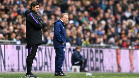 Tottenham Hotspur manager Mauricio Pochettino (left) and Cardiff City manager Neil Warnock on the to