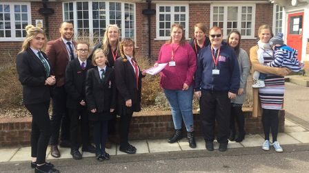 Pupils present a cheque to staff at the charity TOPCATS. Picture: Nick Barker