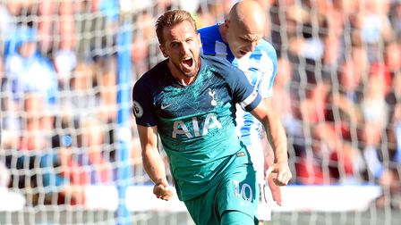 Tottenham Hotspur's Harry Kane celebrates scoring his side's first goal of the game against Huddersf