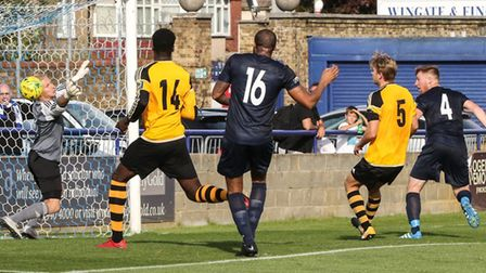Marc Weatherstone (4) heads home for Wingate & Finchley against Merstham (pic: Martin Addison).