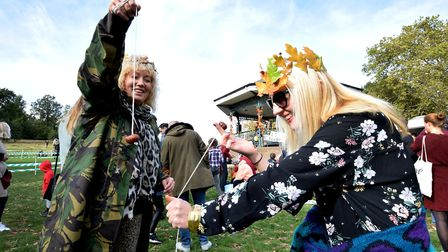 Hampstead Heath Conker Champoinships. Contestants Jacqueline White and Rebecca Skinner hone their te
