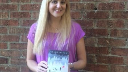 Chloe Mayer with her book which is now out in paperback
