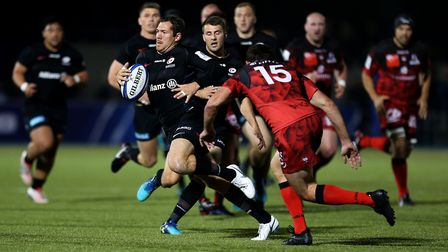 Saracens' Alex Goode is tackled by Lyon's Jean-Marcellin Buttin (pic: Steven Paston/PA)