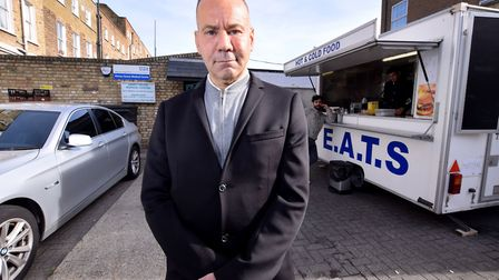 Dr Luke Salih outside the Abney House Medical Centre, which now has a burger van directly outside. P
