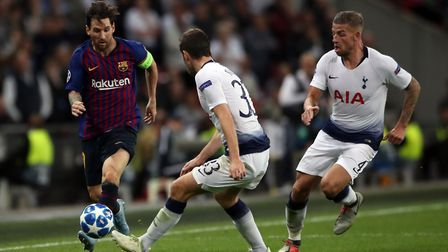 Tottenham Hotspur's Ben Davies and Barcelona's Lionel Messi during the Champions League Group B matc