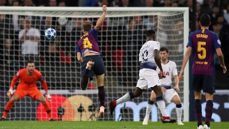 Barcelona's Ivan Rakitic scores his sides second goal during the Champions League Group B match at W
