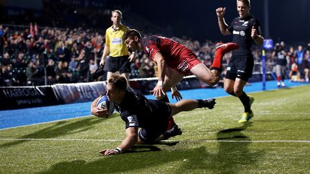 Saracens' Alex Lewington (left) scores his side's fourth try during the Heineken European Champions