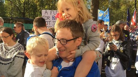 Open Britain Hampstead member Jonathan Livingstone on the people's vote march, with his daughter Cel