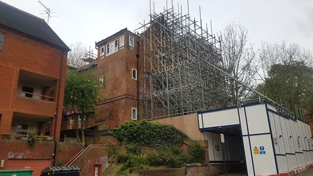 Scaffolding props up 31 Daleham Gardens in the months after the fire