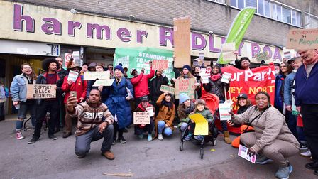 Protesters gather outside Ridley Road Shopping Village. Picture: Polly Hancock