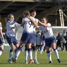 Rianna Dean (nine) is congratulated by her Tottenham Hotspur Ladies team-mates after scoring against