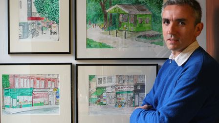 Artist Rob Thom with some of his paintings of East Finchley that will be on display in the Phoenix C