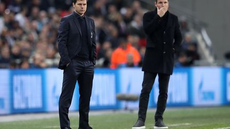 Tottenham Hotspur manager Mauricio Pochettino and PSV Eindhoven manager Mark van Bommel on the touch