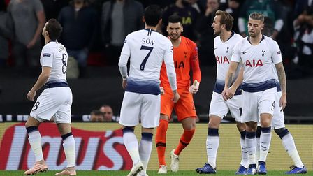 Tottenham Hotspur players react after conceding the first goal to PSV during the UEFA Champions Leag