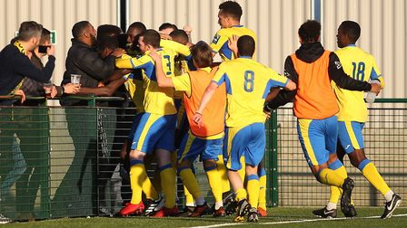 Haringey Borough players celebrate the winning goal scored by Joel Nouble during their FA Cup fourth