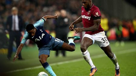 West Ham United's Michail Antonio (right) and Tottenham Hotspur's Kyle Walker-Peters battle for the