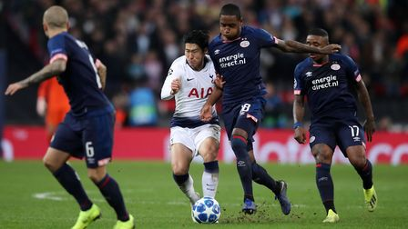 Tottenham Hotspur's Heung-min Son and PSV Eindhoven's Pablo Rosario battle for the ball during the U