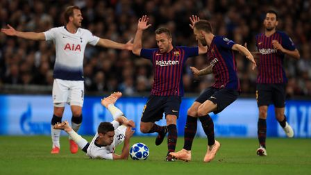 Tottenham Hotspur's Harry Winks is bundled to the floor during the Champions League Group B match at