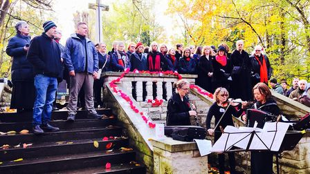 A choir performs Thousands of Leaves at the Remembrance Day service in Abney Park. Picture: Katrina