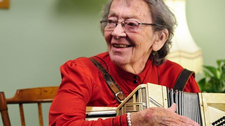 Kindertransport refugee Bea Green with the accordion she brought with her picture: Jon Holloway