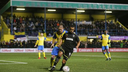 Haringey Borough centre back Mark Kirby and Kwesi Appiah of AFC Wimbledon during the FA Cup first ro