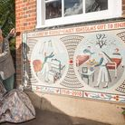 Cllr Oliver Lewis with Romola Jane unveiling the mosaic outside of Konstam Nursery, Highgate Newtown