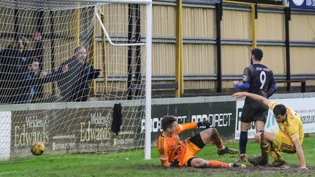 Wingate & Finchley's Charlie Cole finds the net for the Blues on the road (pic: Martin Addison).
