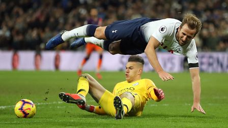 Tottenham Hotspur's Harry Kane goes to ground from a challenge by Manchester City goalkeeper Ederson