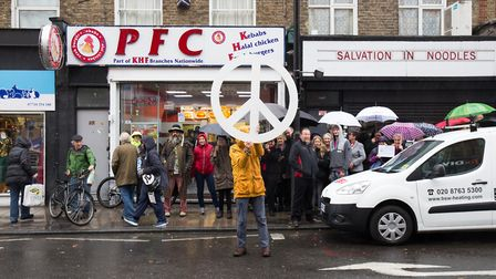 Crowds gathered to watch the unveilling of the peace plaque in Blackstock Road. Picture: Hackney Cou