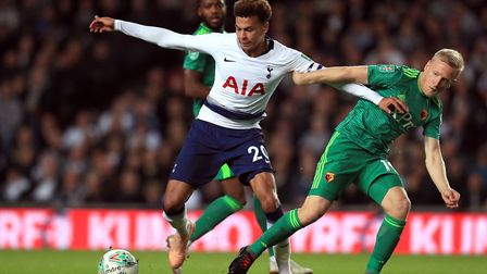 Tottenham Hotspur's Dele Alli (left) and Watford's Will Hughes battle for the ball at Stadium MK (pi