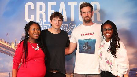 Winners Rachael Corson (left) and Jocelyn Mate (right) receive £275,000 with Ashton Kutcher and Migu