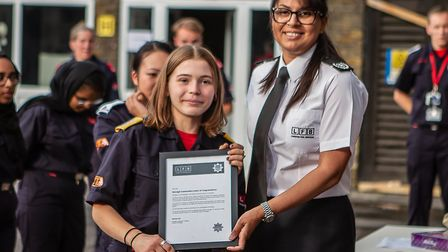 Edie receives letter of commendation from borough commander Narinder Dail at pass out ceremony. Pict
