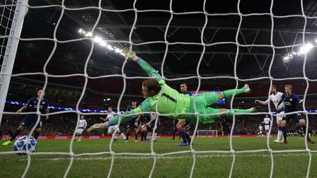 PSV's Jeroen Zoet is unable to stop a header from Tottenham Hotspur's Harry Kane during the UEFA Cha