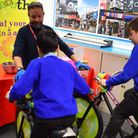 Argyle Primary School pupils ride the smoothie-making bikes during Camden Council's takeover challen