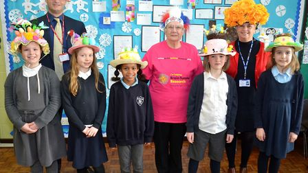 Peter Aldous, Barbara Shaw and Kate Schonhut with some pupils sporting their hats. Picture: Mick How